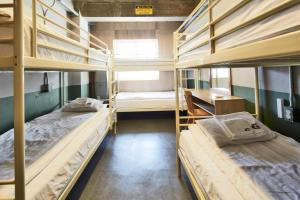 A bunk bed or bunk beds in a room at G Guesthouse Itaewon In Seoul