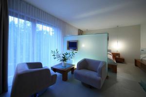 Un lugar para sentarse en Smilčių Boutique Hotel, Tubinas Hotels