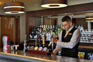 The lounge or bar area at Best Western Heath Court Hotel
