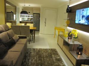 Uma área de estar em Apartamento Centro Catedral