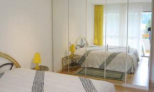 Ein Bett oder Betten in einem Zimmer der Unterkunft Residenz Larix Apartments