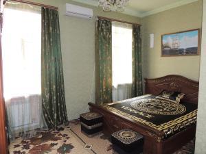 Кровать или кровати в номере Hotel Parnas