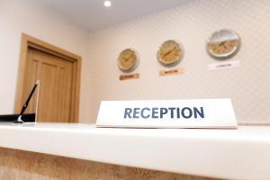 Лобби или стойка регистрации в Апарт-отель Даудель Тюмень Центр
