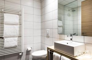 A bathroom at Storm Hotel by Keahotels