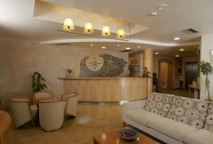 The lobby or reception area at Hotel Sa Volta