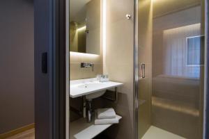 Een badkamer bij Cler Hotel