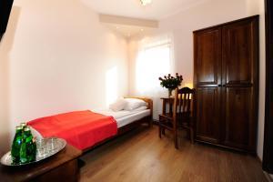 Łóżko lub łóżka w pokoju w obiekcie Willa Julia