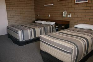 A bed or beds in a room at Mount Wycheproof Motor Inn