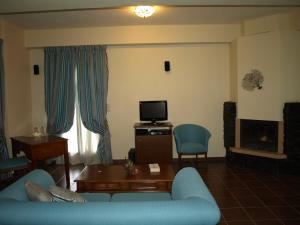 Χώρος καθιστικού στο Porto Mani Suites