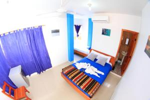 A bed or beds in a room at Costa Del Sol