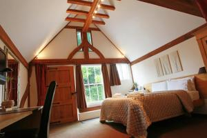 A bed or beds in a room at Tonge Barn