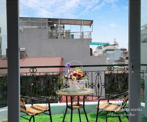 A balcony or terrace at Hanoi Old Quarter Hostel