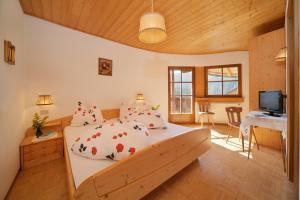 Letto o letti in una camera di Gasthof Meierei