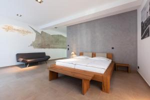 Ein Bett oder Betten in einem Zimmer der Unterkunft B&B Altes Rathaus