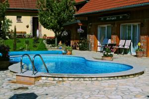 The swimming pool at or near Gasthaus Joó-Wellness Pension