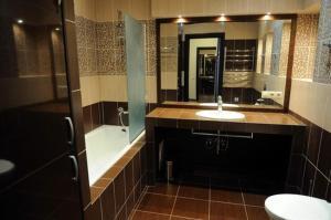 A bathroom at Pleasure Apartment near center of Odessa