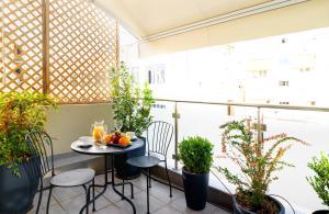 A balcony or terrace at Phidias Piraeus Hotel