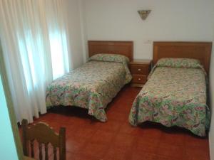 Cama o camas de una habitación en Hospedaje Magallanes