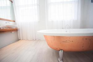A bathroom at Lace Market Hotel Nottingham by Compass Hospitality