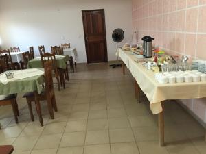 A restaurant or other place to eat at Romax Hotel