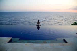 The swimming pool at or near Villa Infinite Horizon