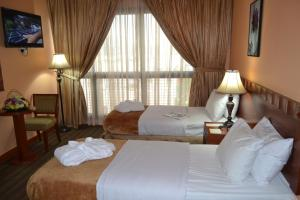A bed or beds in a room at Top Stars Hotel