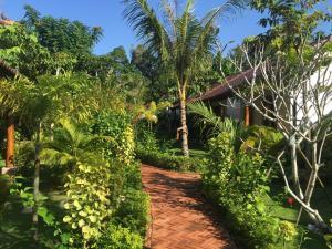 A garden outside La Mer Resort