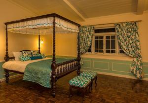 A bed or beds in a room at Ging Tea House