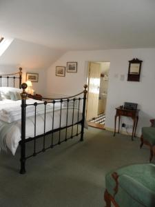 A bed or beds in a room at Holly Tree House Bed & Breakfast