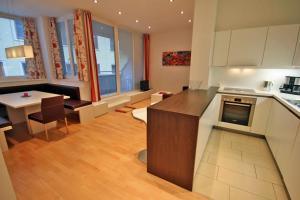 Kuchyň nebo kuchyňský kout v ubytování Appartements Tamino by Schladming-Appartements