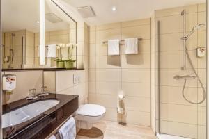 Ein Badezimmer in der Unterkunft CityClass Hotel Residence am Dom