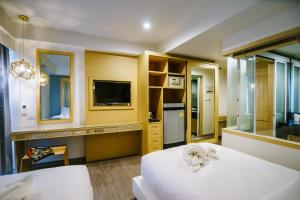 A television and/or entertainment center at Moon Dragon Hotel