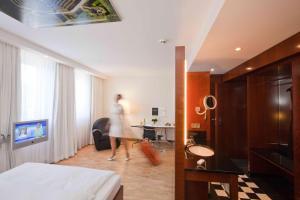 Телевизор и/или развлекательный центр в Grand Hotel Mussmann