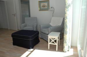 Ein Sitzbereich in der Unterkunft Boardinghouse