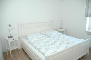 Ein Bett oder Betten in einem Zimmer der Unterkunft Boardinghouse