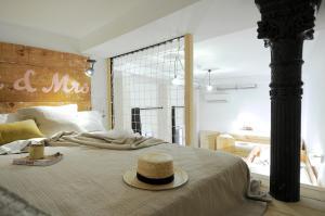 Cama o camas de una habitación en The Hat Madrid