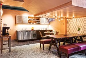 A kitchen or kitchenette at Sofo Hotel