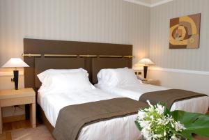 Letto o letti in una camera di Grand Hotel Duca Di Mantova