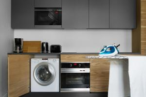 A kitchen or kitchenette at STRADONIA Serviced Apartments