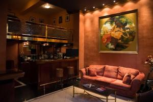 The lounge or bar area at Alfa Hotel
