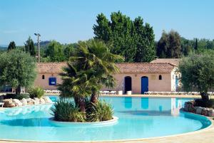The swimming pool at or near Domaine Le Clos des Oliviers