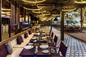 A restaurant or other place to eat at Maxx Royal Kemer Resort