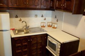 A kitchen or kitchenette at Castelo Beach Hotel