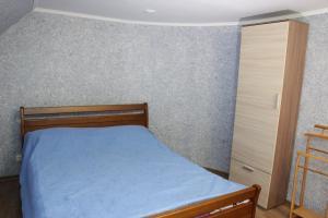A bed or beds in a room at Tsarska Dolina