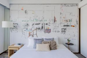 מיטה או מיטות בחדר ב-Hotel Stage