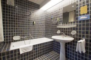 Ein Badezimmer in der Unterkunft Hotel Garni Römerhof