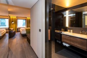 A bathroom at Stadthotel Brunner