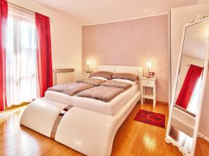 A bed or beds in a room at Apartments Cvek