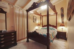A bed or beds in a room at Mary's Boon Beach Plantation Resort & Spa