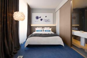 Ein Bett oder Betten in einem Zimmer der Unterkunft Hotel Cubo